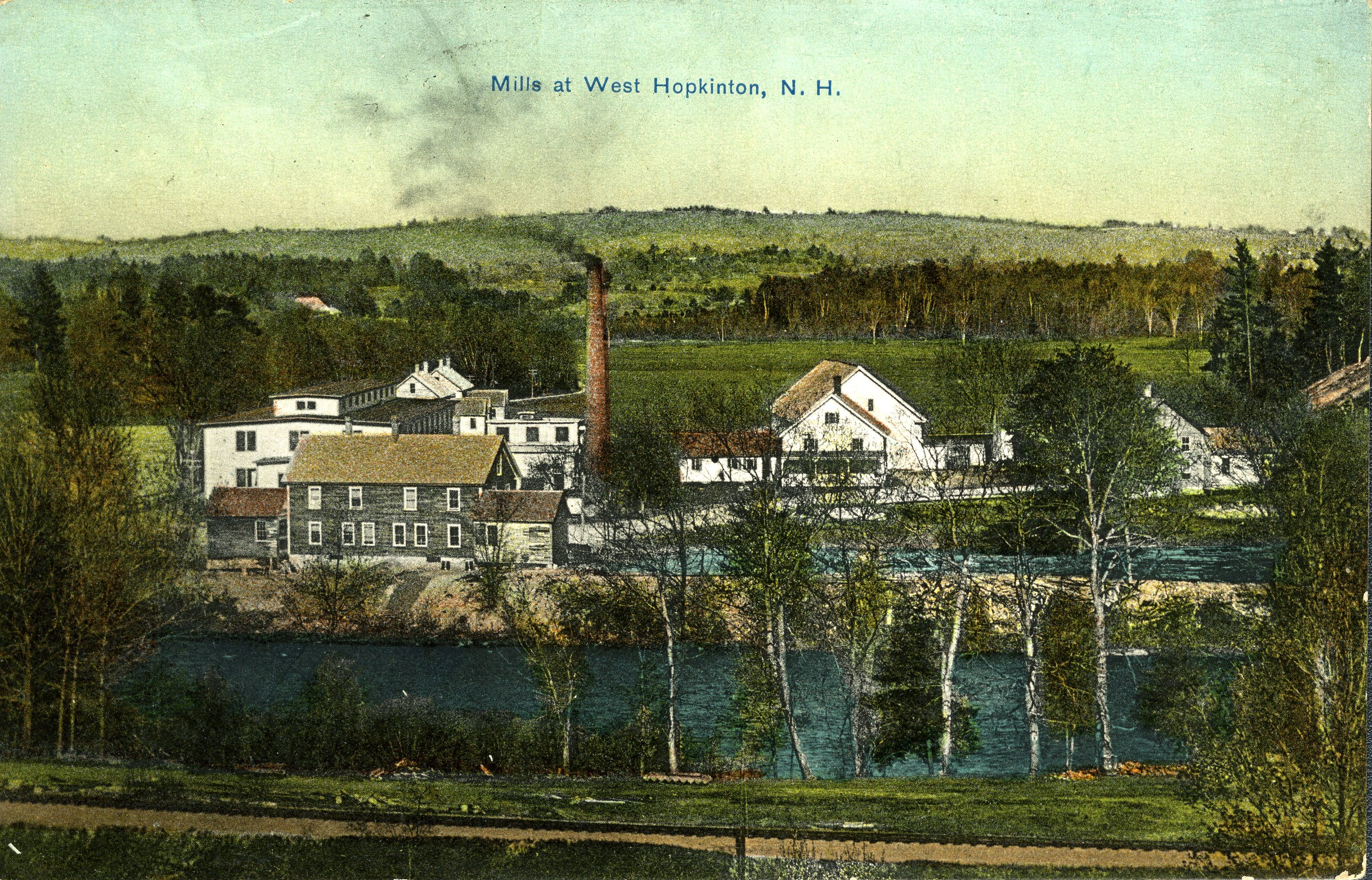 An early 20th-century postcard with a colorized photo of the mills at West Hopkinton.  Visible in the foreground are the railroad tracks that delivered fuel to the facility.