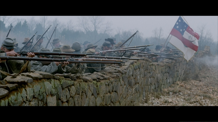 Scene from Gods and Generals depicting Confederate soldiers firing from the stone wall