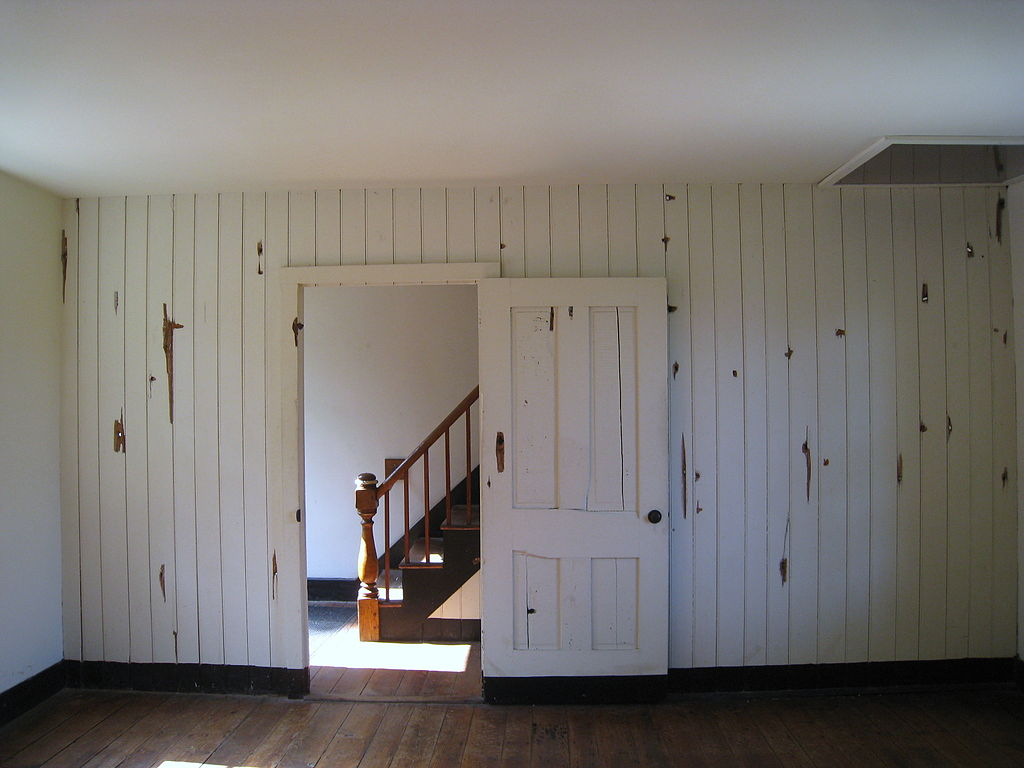 Interior of Innis House. Bullet homes pockmark the walls