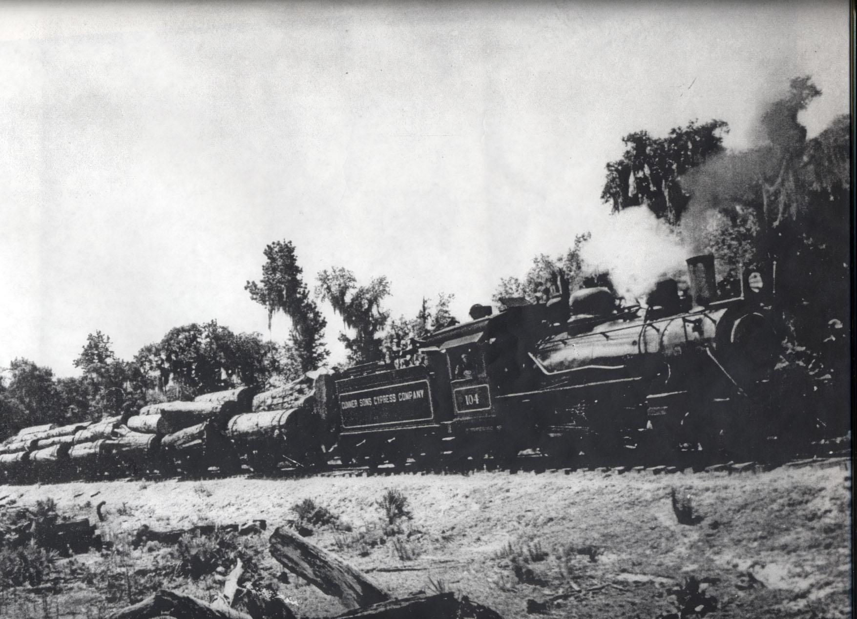 Cummer locomotive pulling load of cypress logs.