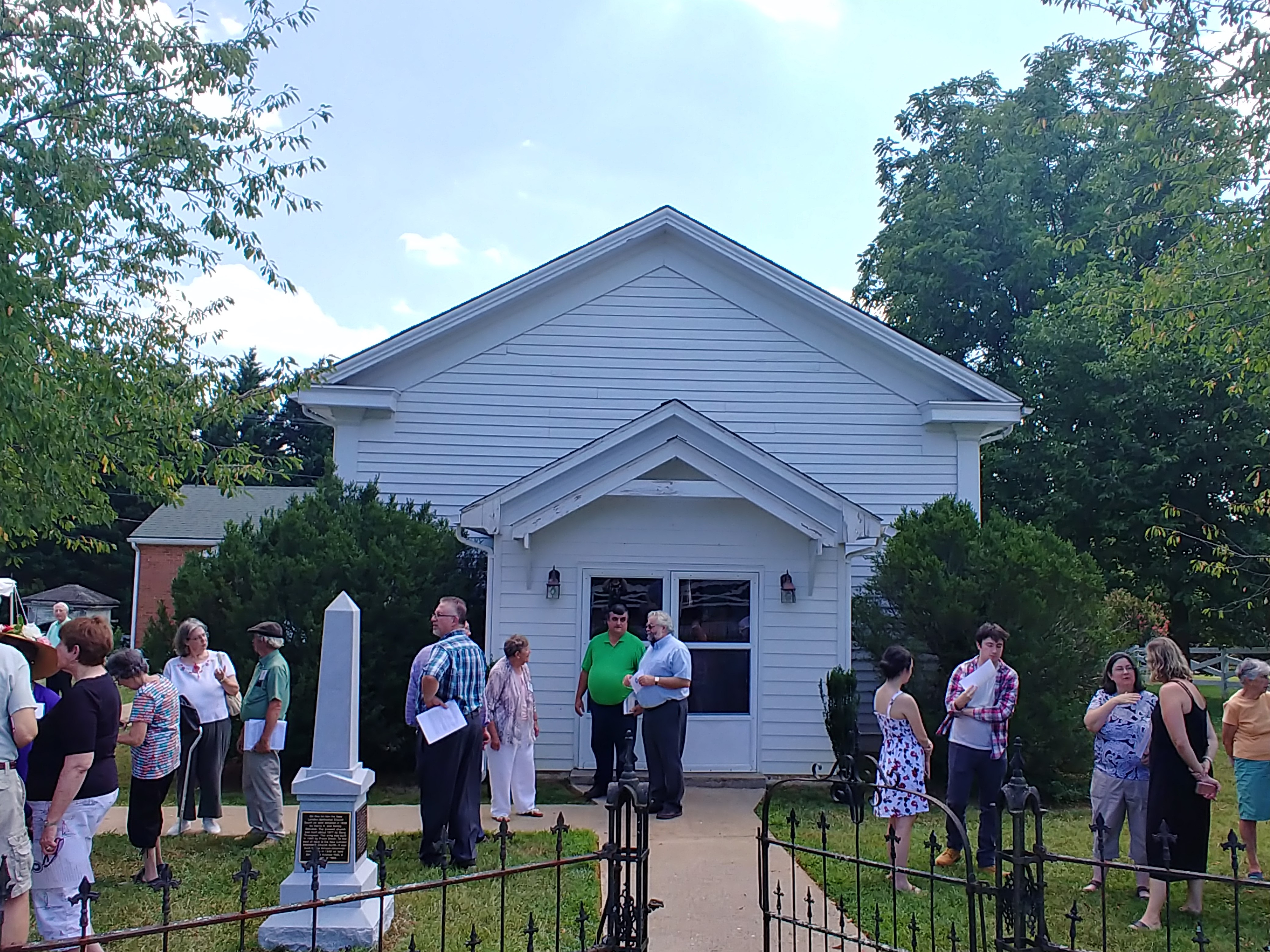 front of the New London United Methodist Church during monument dedication