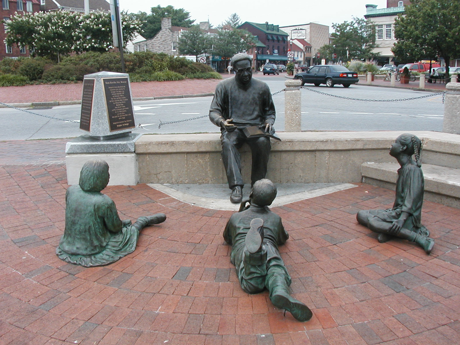 Statue of Alex Haley and Three Eager Listeners