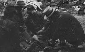 Zoomed in frame of Union soldiers helping their wounded comrades