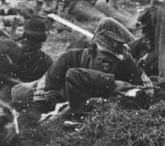 Another close up scene of Union comrades helping their fellow wounded