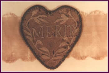 """The original """"Badge of Merit"""" awarded by General George Washington in 1782."""