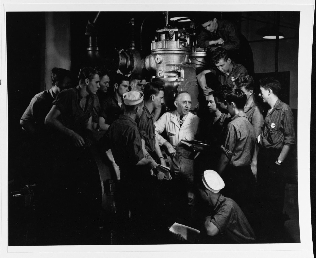 """Navy trainees receive instruction at the """"Diesel School"""" at Navy Pier in 1942. The government took over the huge facility and converted it into a Navy base during World War II."""