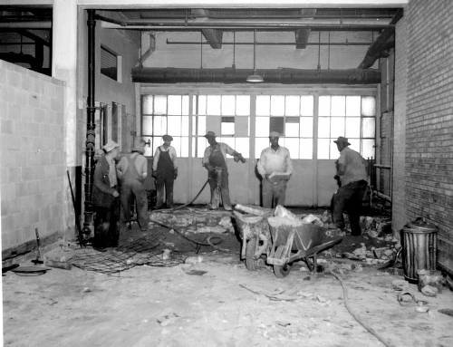 Construction workers clean up the facility in 1946, in preparation for the University of Illinois' impending move into the facility. The University's branch would remain for nearly two decades.