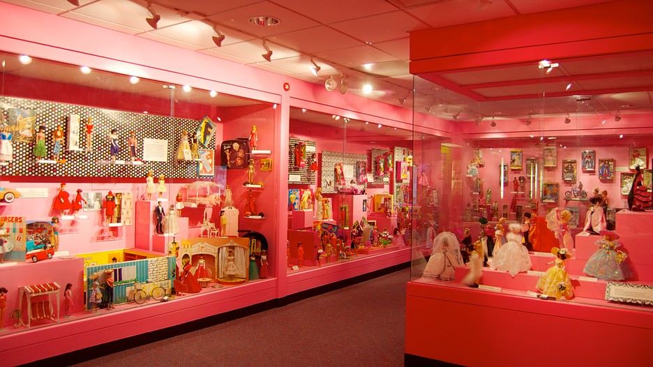 Displays of dolls and other toys show how the way children have been raised changes over time.