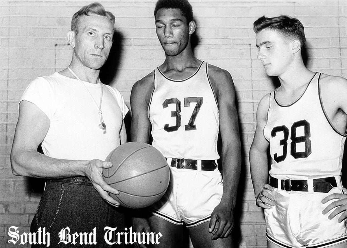 Coach John Wooden with players Parson Howell and Wayne Thompson