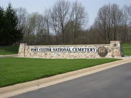 A stone wall marks the entrance to the grounds of the cemetery.
