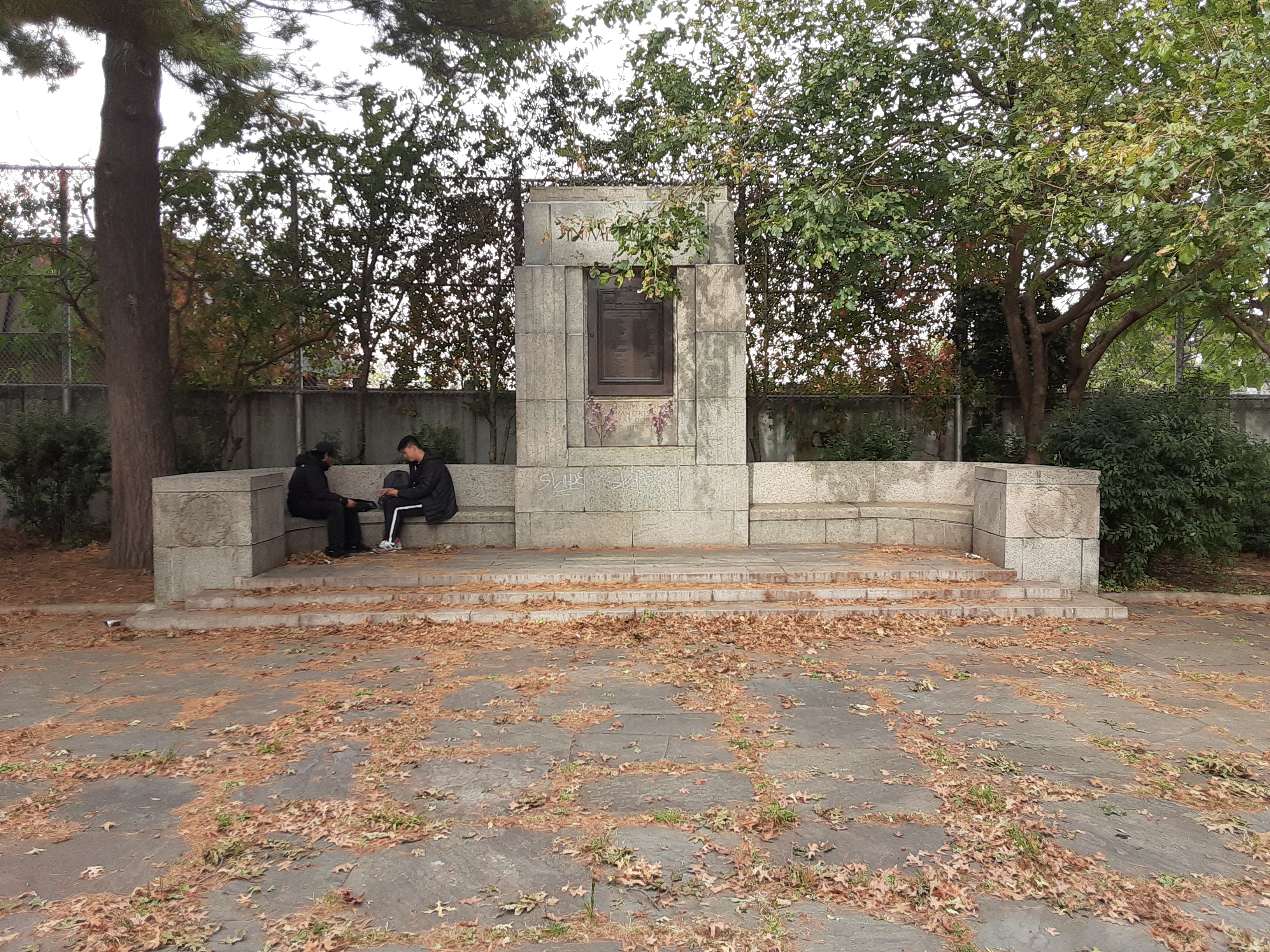 The Memorial with sitting people for scale.