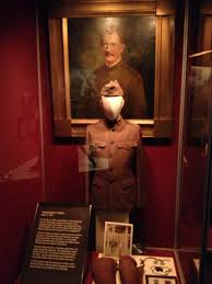 A soldier's uniform from war on display in the Military Museum