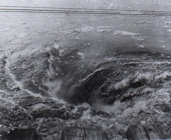 Whirlpool caused by water pouring into the mine shaft.  Photo by William R. Lukasik, copyright Lukasik Studio Archives.