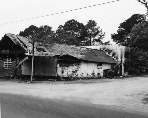 Photo showing the aftermath of the fire that all but destroyed Crow's Grocery Store and killed Travis Crow.