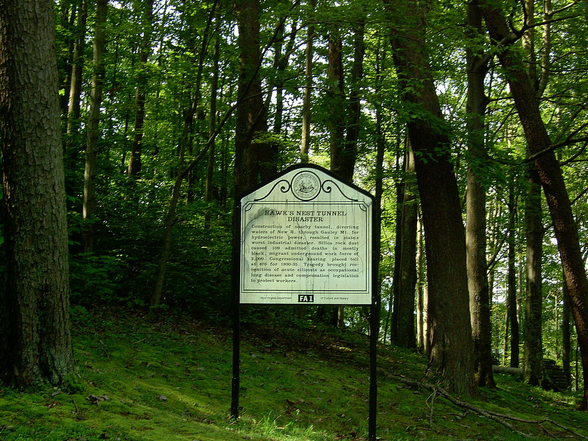 Historical marker related to the Hawks Nest Tunnel Disaster, one of the worst industrial disasters in American history. According to a historical marker on site, there were 109 admitted deaths. A Congressional hearing placed the death toll at 476