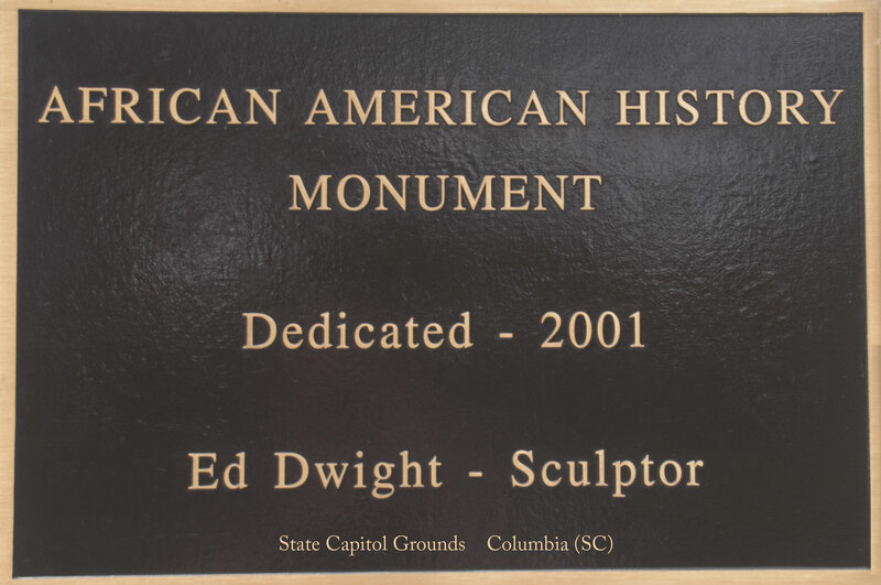 Plaque on the front of the monument.