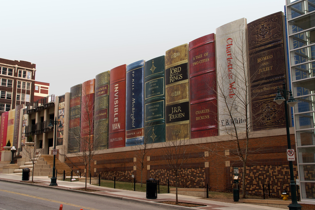 The south wall of the library's free parking garage is known as the Community Bookshelf. The wall was made by creating 25-foot book spines out of mylar signboard for each of the 22 books that were selected by community members in a 2004 contest.