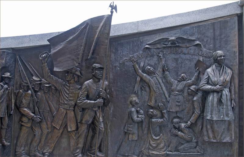 Scenes of black history depicted on the bronze panels.
