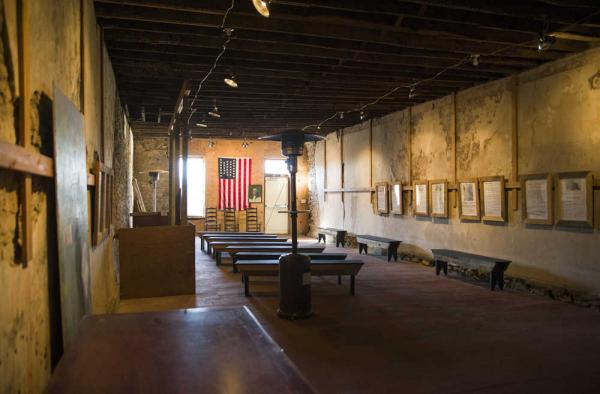 Despite extensive damage owing to years of neglect, the interior of the historic building is now open and used for school tours and other events.