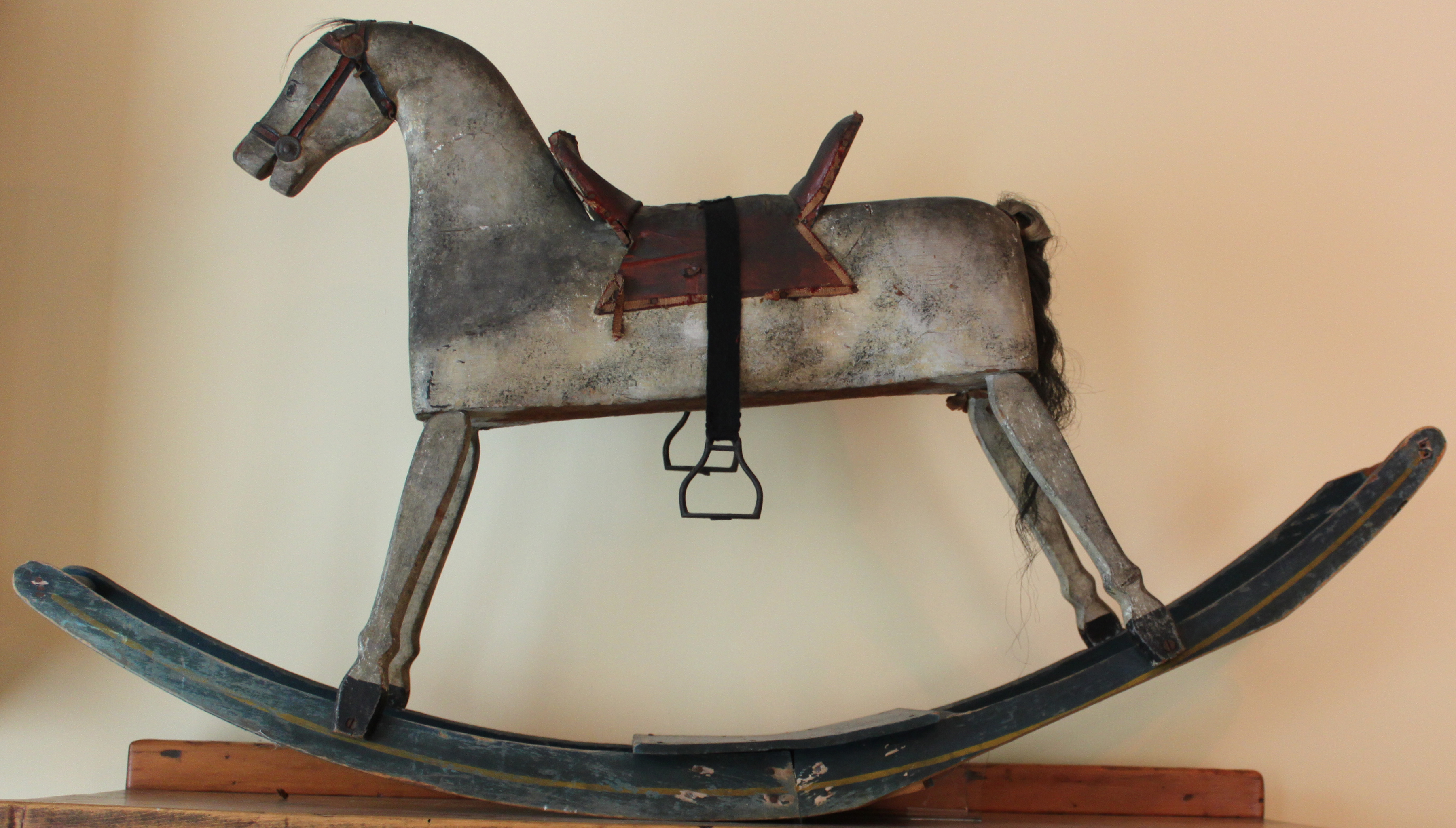 Painted wood rocking horse with hair tail