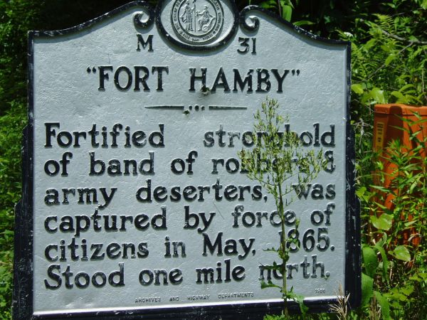 The maker close to the site of the Hamby house, which commemorates the battle fought between the Bushwhackers and the Federal troops sent to apprehend them .