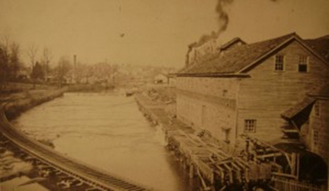 An old photo depicting the Reedy River Industrial complex in the mid 1800s.