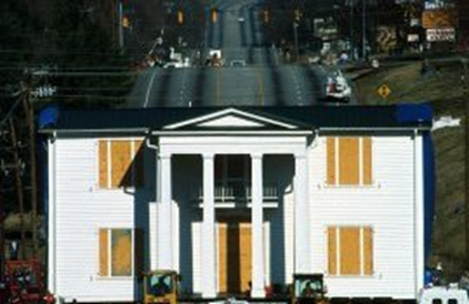 A photo of the Cherrydale House being physically moved from its' original location, to a closer spot on Furman's campus.