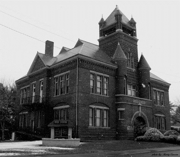 A photograph of the Rose Center taken during the winter in a black and white format.