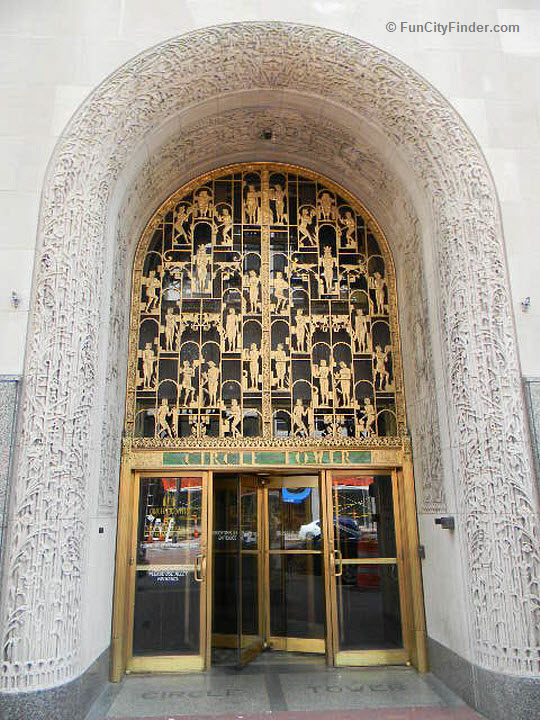 Circle Tower's Market Street entrance features a 1.5 story carved arch, hieroglyphic-like images and a revolving door.