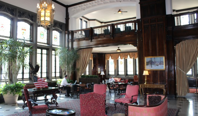The Columbia Club's grand first floor lobby is furnished with floor-to-ceiling walnut paneling.