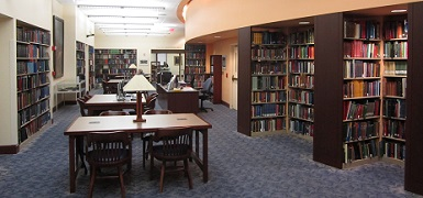The library reading room is surrounded by published books about West Virginia history. This represents only a small portion of the library's collection.
