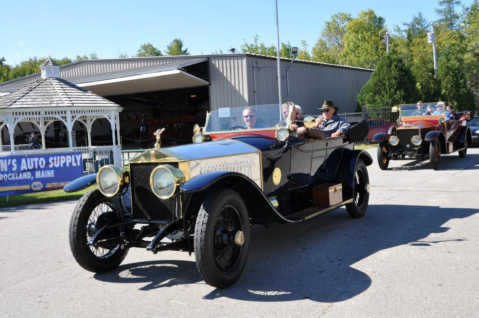 Two 1913 Rolls-Royce Silver Ghosts enter the OHTM show grounds after taking a scenic spin around the coastal roads near of Owls Head.
