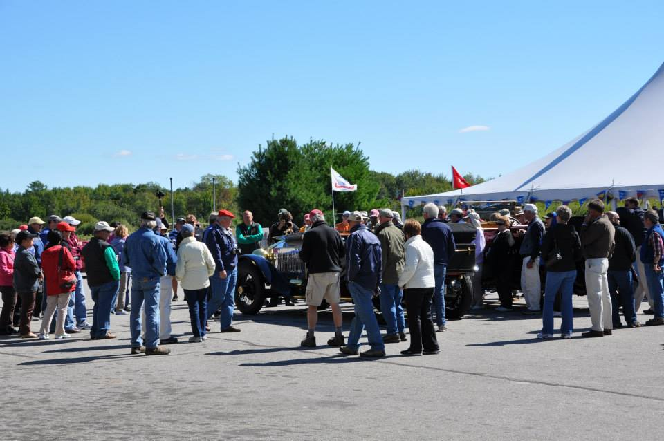 A crowd gathers as a museum collection vehicle is demonstrated at one of the organization's myriad annual seasonal events.