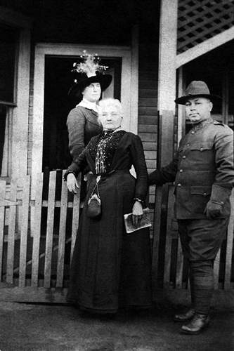 Mother Jones in front of the Pratt Boarding House where she was imprisoned temporarily in 1913.