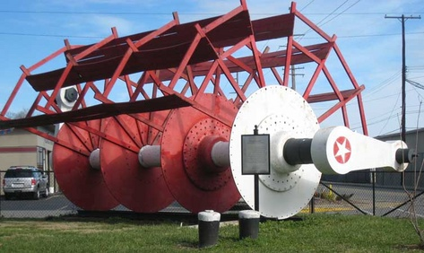 The museum grounds include paddlewheels, pilothouses, and several other displays related to the steamboat industry.