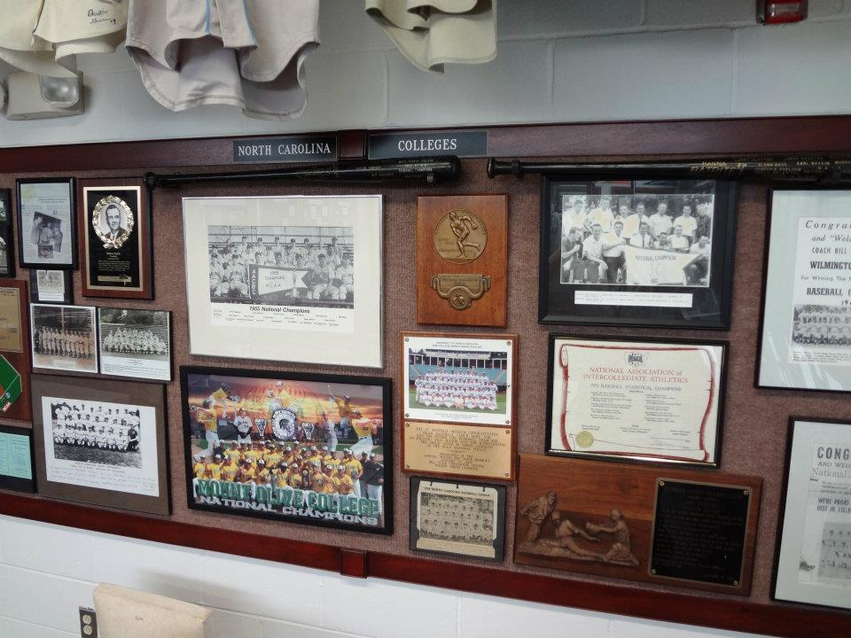 Historic Fleming Stadium Clubhouse Lockers complete with era uniforms, caps and equipment.