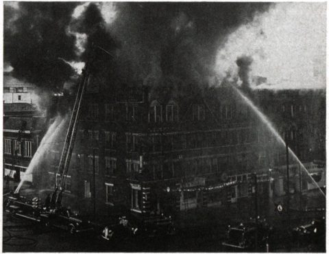 Firemen fight the fire at the Adelphia on Christmas 1950