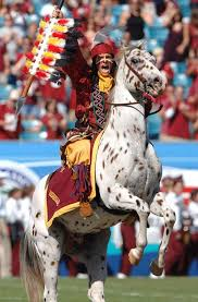 Chief Osceola and Renegade storming the field before a game.