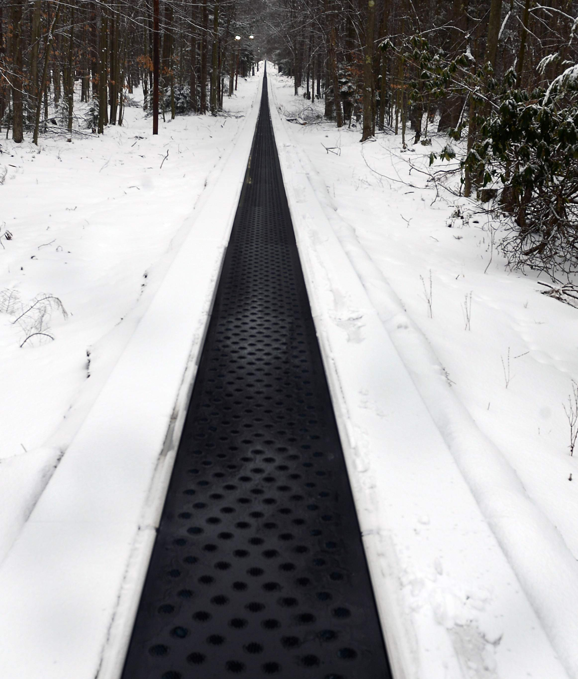 This is some of the 1400 foot long conveyor used to bring people back up the mountain after they sled down. It is possibly the longest conveyor in America today.