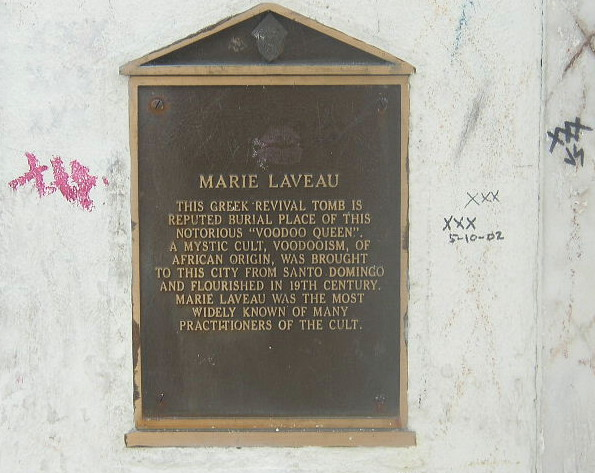 The plaque on the tomb. It tells the history of the crypt and the woman who might be inside of it.