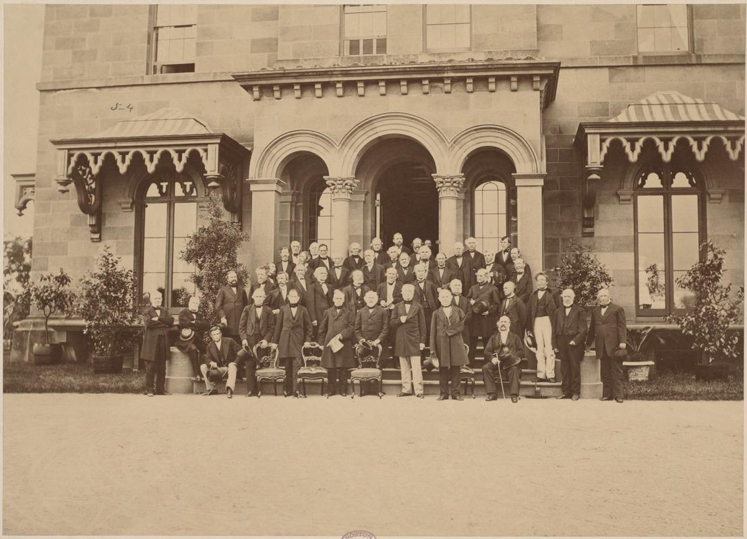 Photograph taken June 10 1869 of Society members standing on the front steps of Society President R.C. Winthrop's house in Brookline (Courtesy Massachusetts Historical Society)