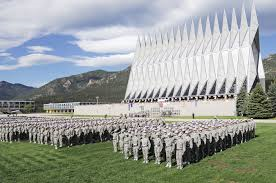 Cadets stand in formation next to the Cadet Chapel, which is one of most visited sites in Colorado.