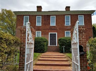 Exterior of Pembroke Manor Showing Gate