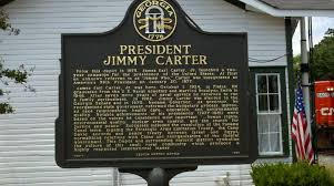 A sign commemorating what was once President Jimmy Carter's first campaign headquarters