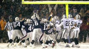 "Adam Vinatieri kicking the game winning field goal in overtime to defeat the Oakland Raiders in ""The Tuck Rule Game"".  This win allowed the Patriots to go to the Super Bowl."