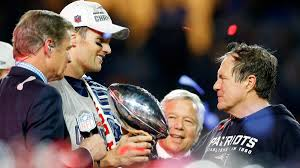 New England Patriots owner Robert Kraft, Head Football Coach Bill Belichick, and Franchise Quarterback Tom Brady celebrating after the Patriots won Super Bowl XLIX on February 1, 2015.