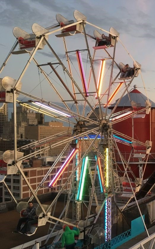 The fully functioning ferris wheel on the roof offers a grand view of the city.