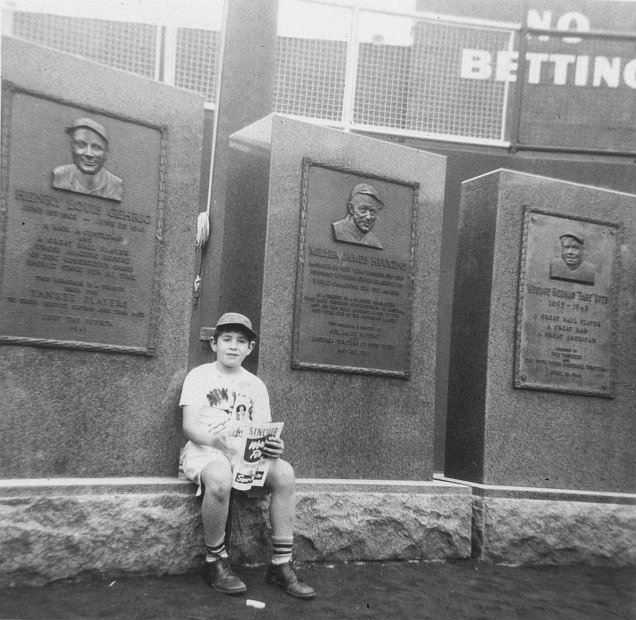 Young boy visiting the monuments located in center field of Yankee Stadium, 1951.