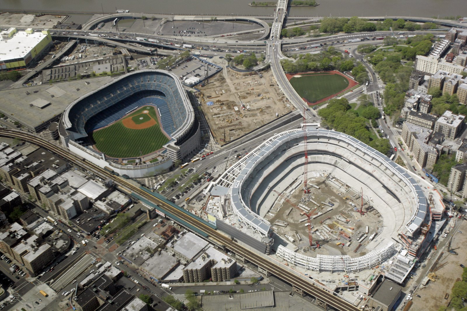 Old Yankee Stadium on the left and the construction of the New Yankee Stadium on the right.