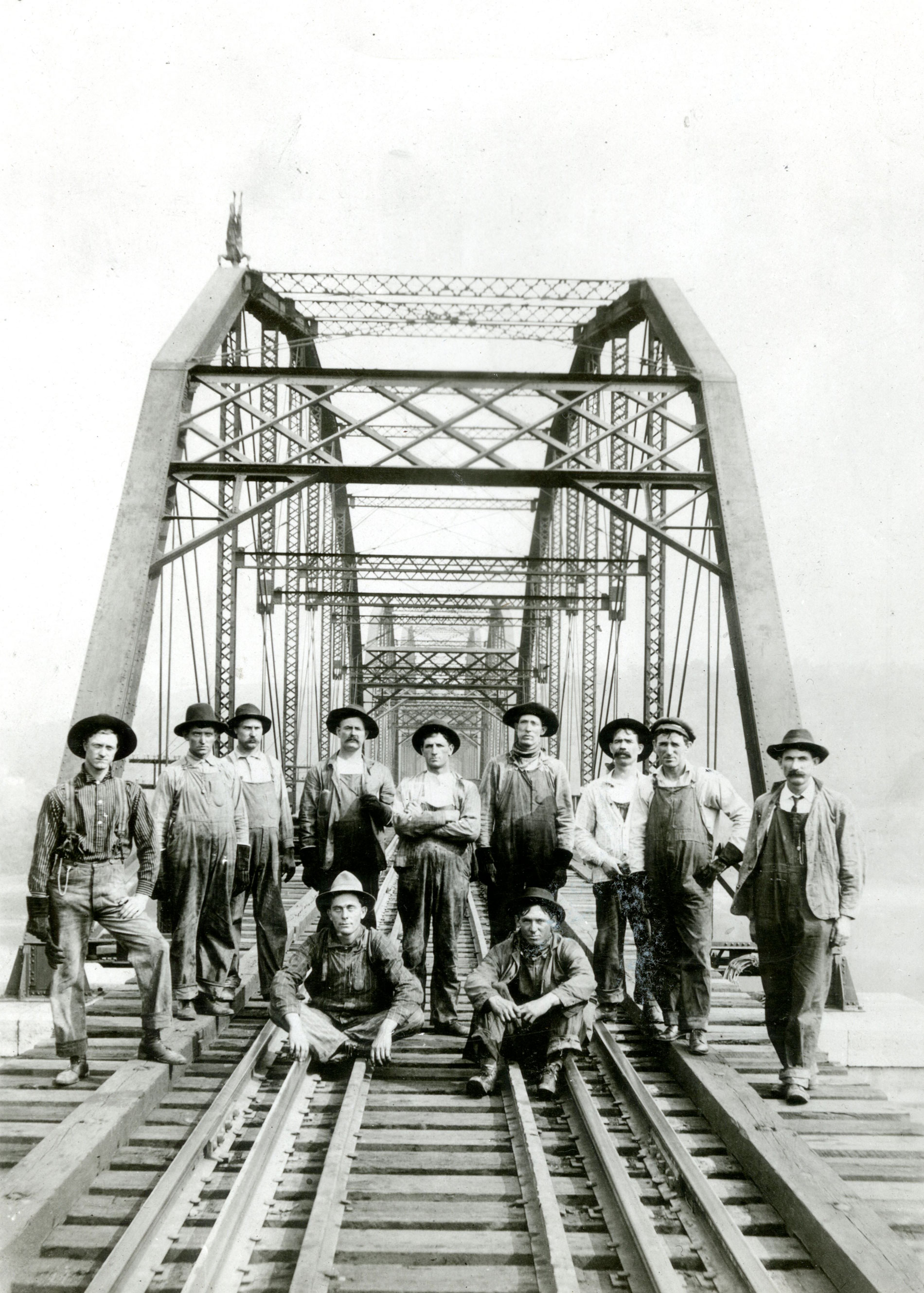 N & W workers standing on the newly competed bridge.